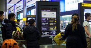 Heathrow Express and taxi comparison smart screens installed at Heathrow Terminal 2
