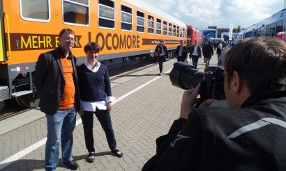 locomore-at-innotrans%3b-derek-ladewig-and-katrin-seiler-being-photographed-lr