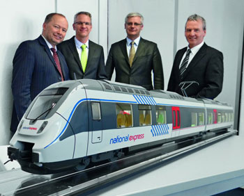 (from left) Tobias Richter, Managing Director, National Express Rail GmbH; Volker Kregelin, Vice President Business Development, Bombardier Transportation; Norbert Hübner, Sales Manager, Bombardier Transportation; Wolfgang Schuster, General Manager, National Express Rail GmbH