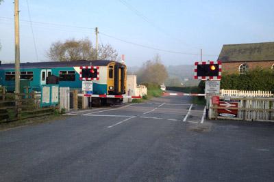 Open level crossing barrier programme complete