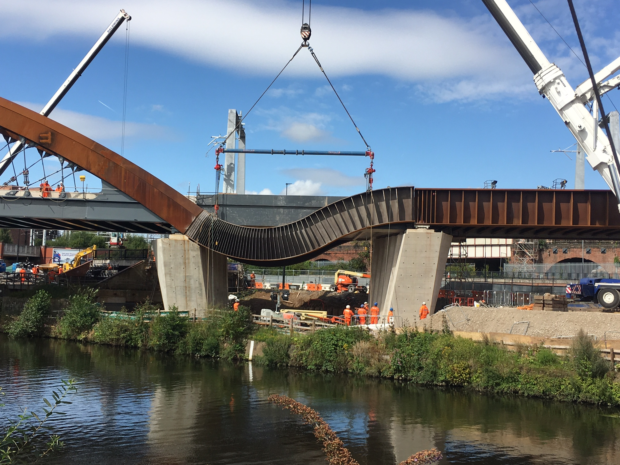 Twin steel bands for the Ordsall Chord are lifted into place