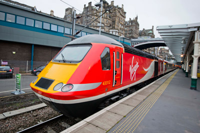 "Virgin Trains East Coast will receive a £21 million overhaul of its 45 high speed diesel trains as part of a £40 million commitment to improve its fleet since launching the east coast franchise in March 2015. The programme is part of a package to invest £140 million over eight years. The £21 million investment will be spent on the complete refurbishment of the train's interiors. A total of 401 carriages will be overhauled with 24,123 seats replaced along with refurbished toilets, new carpets and curtains. Leather seats will be fitted in First Class. Upgrade work will be carried out at Virgin Trains Bounds Green depot in London and its Craigentinny depot in Edinburgh, where it will also fit 35 new engines to its diesel high speed train fleet as part of a £16 million contract with engine manufacturer MTU. External work will also be carried out on the trains taking the investment to more than £40 million. David Horne, Managing Director of Virgin Trains on the east coast route, said: ""Since Virgin started running this railway, the bar has been raised by customers who rightly demand a high quality customer experience, something which they would expect from a Virgin business, as well as getting great value for money. ""And that's exactly what we've been working hard to deliver, with this multi million investment in our trains not only one of the biggest investments of its kind ever seen on the east coast route, but also three years ahead of the introduction of new Super Express Trains as part of the Government's InterCity Express programme. ""We're investing now so our customers can benefit from new seats and a great new on-board environment before we get a new fleet of 65 trains from 2018."" The first refurbished train will enter service on 14 December 2015 coinciding with the launch of Virgin Train new service between Sunderland and London. Trains East Coast to receive 21 million pound refurbishment"