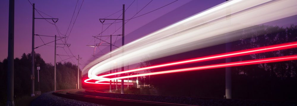 Lights from a speeding train at night