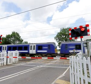 Train speeding through level crossing in the United Kingdom